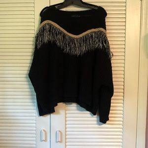 Black sweater with fringe design